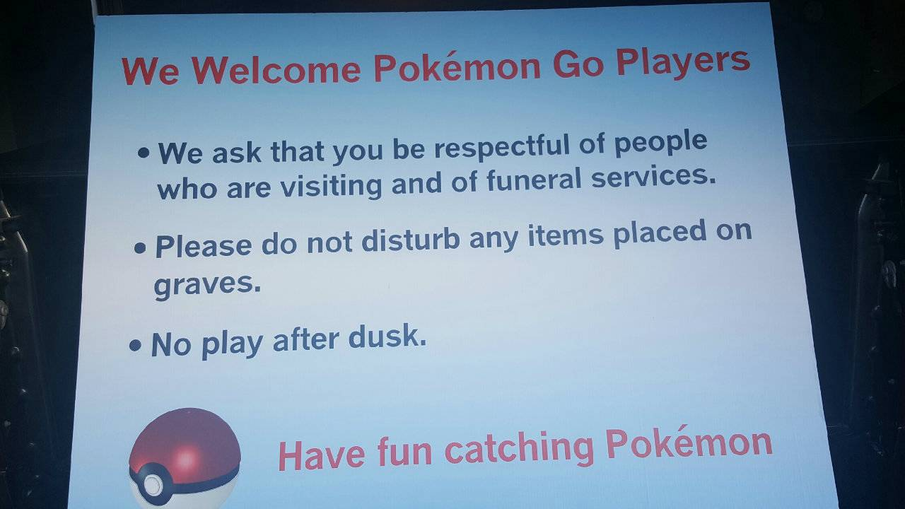 Welcome Pokemon Go players sign at cemetery