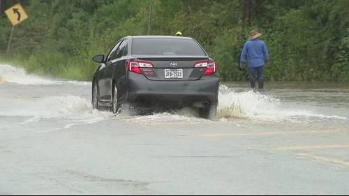 Heavy rain floods roads in Dickinson