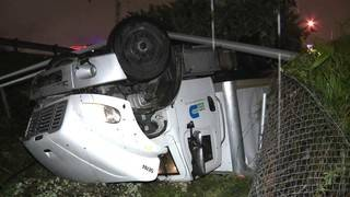 Miami-Dade County work truck overturns, lands upside-down next to I-95