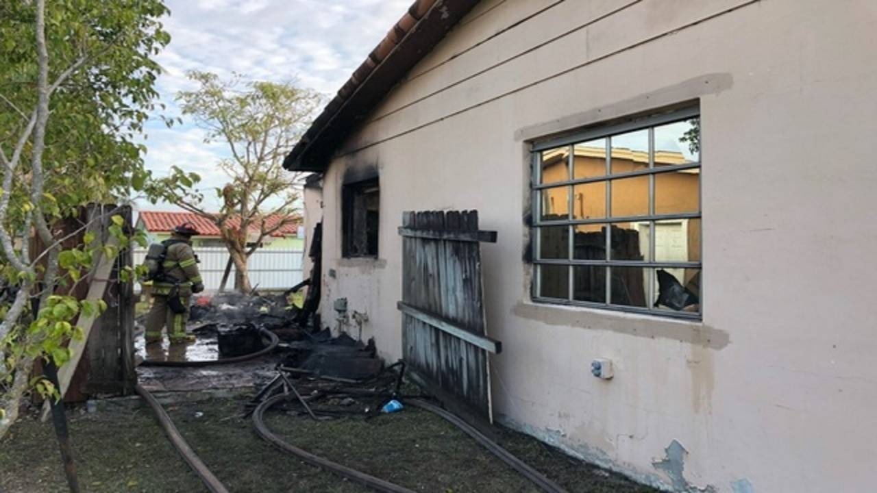 Firefighters examining damage to SW Miami-Dade home