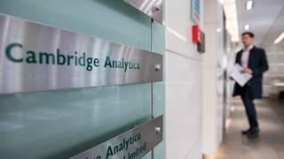 Investigators search Cambridge Analytica's London offices