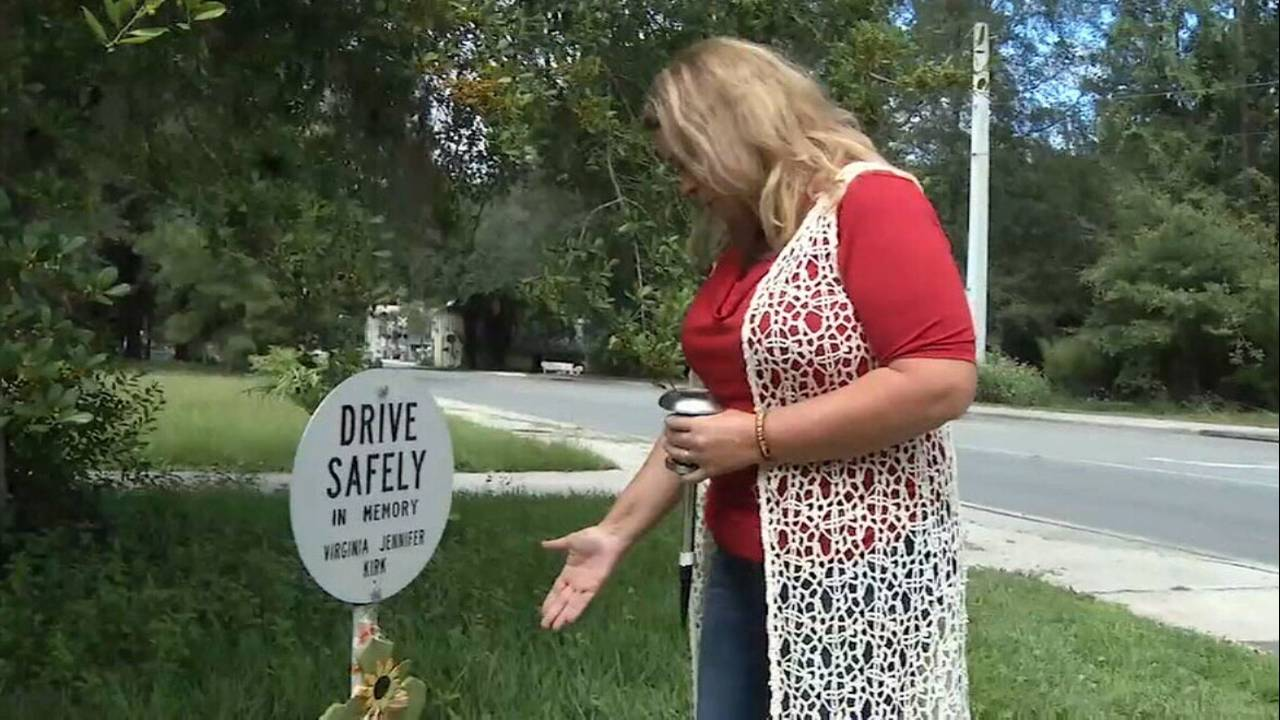 Debbie Pruitt stands at marker where her daughter died