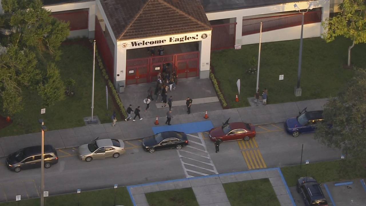 Sky 10 above 'Welcome Eagles!' sign on first day of new school year at Marjory Stoneman Douglas High School