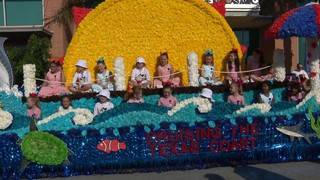 Thousands line downtown for Battle of Flowers Parade