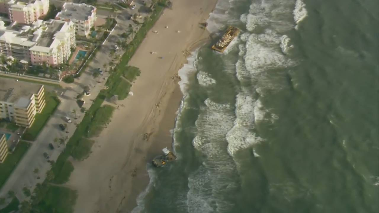 Sky 10 of boat and barge aground in Deerfield Beach