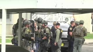 Body camera video shows children rescued during tense hostage standoff