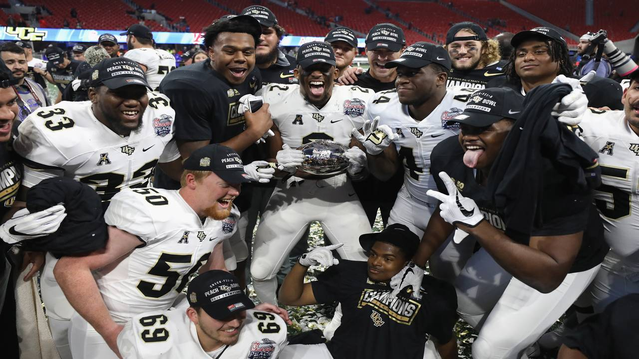 UCF Knights players celebrate Auburn victory in Peach Bowl