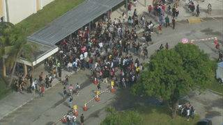 Dozens of students walk out of Western High School in support of security guard