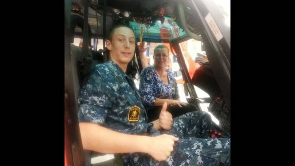 Vinny in cadet uniform sitting in Coast Guard helicopter with Mom, Donna Becklin_1542675930372.jpg.jpg