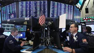 Dow falls 300 points as trade war fears escalate