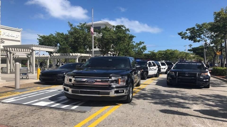 Police cars outside North Miami Beach Walmart