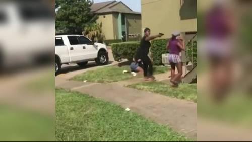 Woman pulls gun during fight between teenage girls