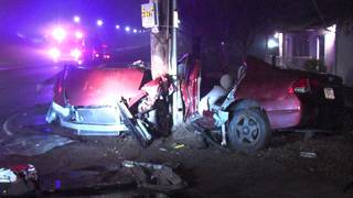 Impact of crash causes utility pole to split