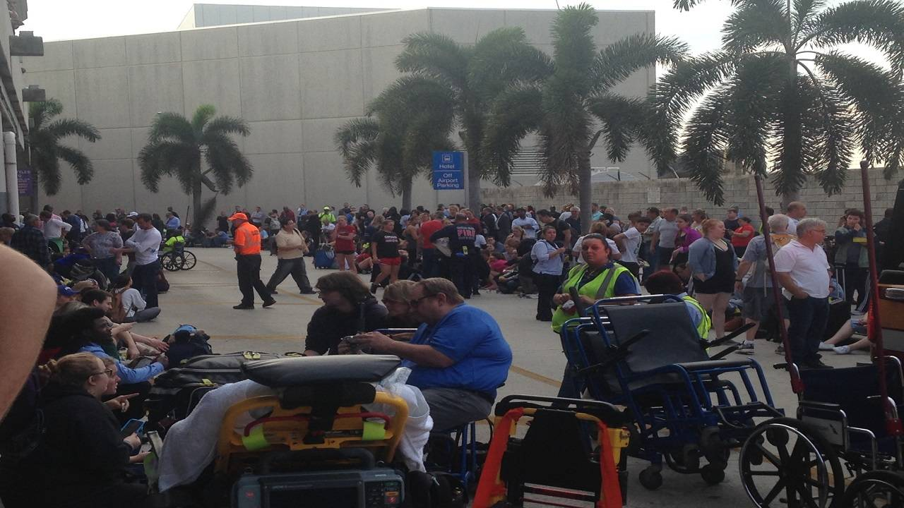 Crowd of passengers outside FLL