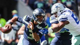 Wilson 3 TDs, Thomas 2 picks, Seahawks beat Cowboys 24-13