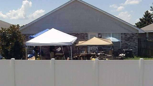 Body-found-in-backyard.jpg_33636654