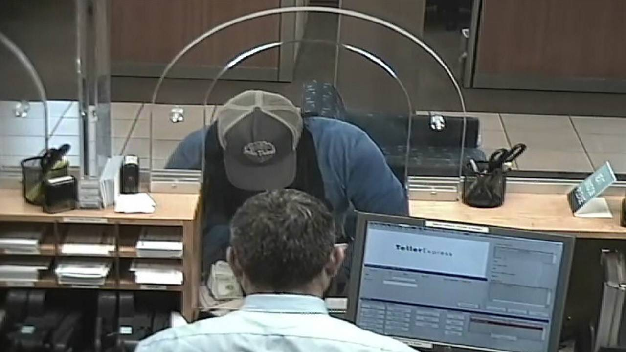 Robber getting cash at Chase Bank in Pompano Beach