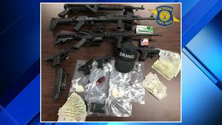 Drugs, assault rifles, heroin processing area found during