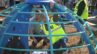 Volunteers help build new YMCA playground