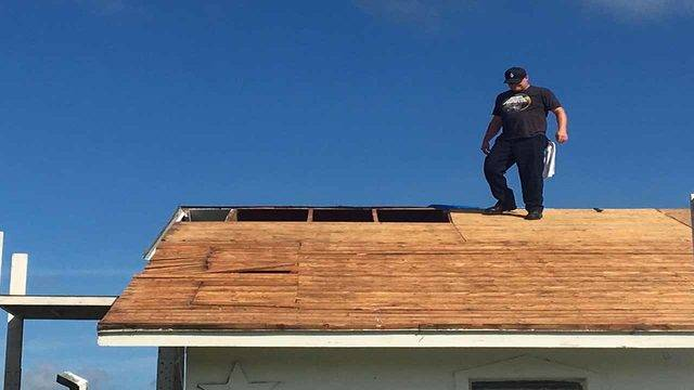 firefighters roof 3_1534096493407.jpg.jpg