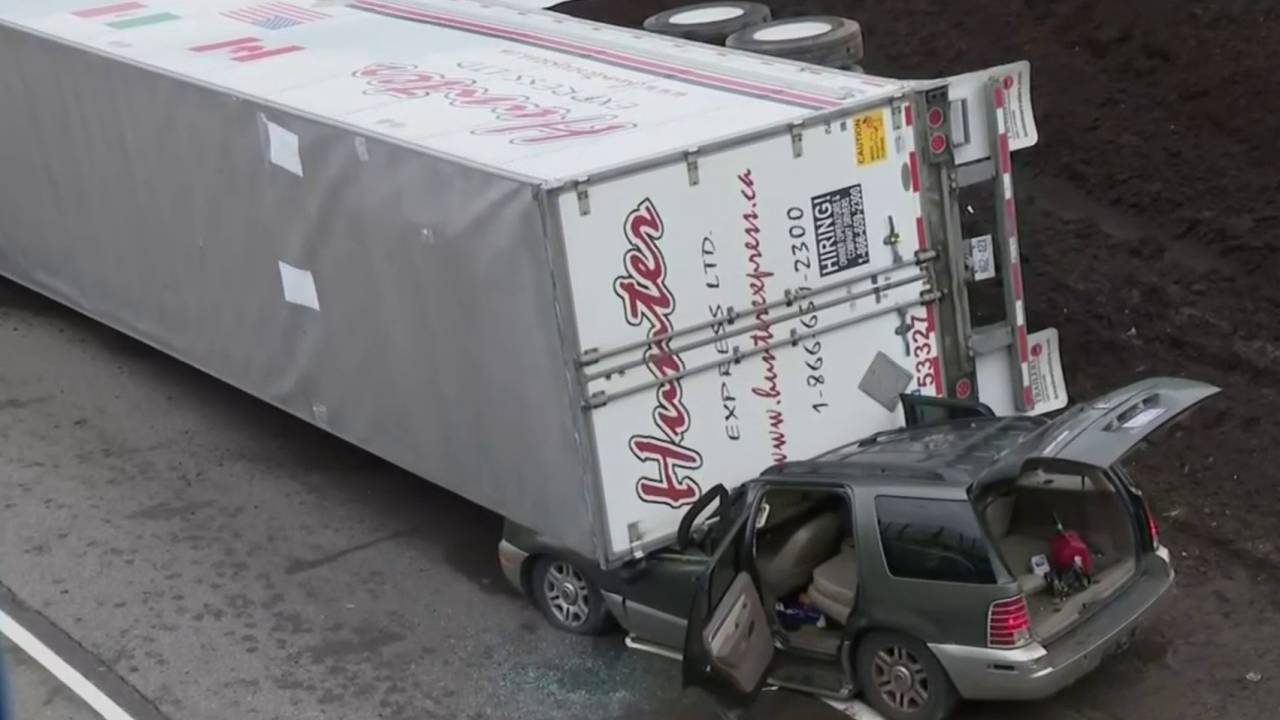 Pickup truck falls on top of SUV 1