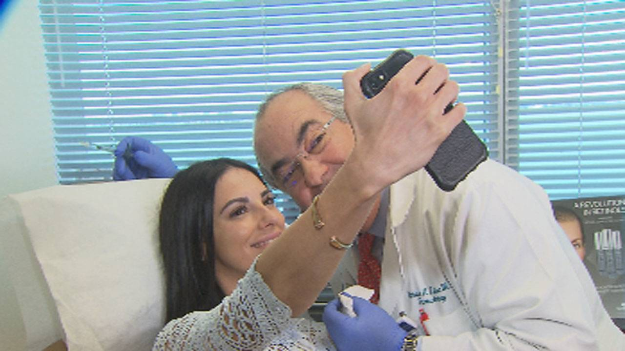 woman-takes-selfie-with-doc_1494892680933.jpg