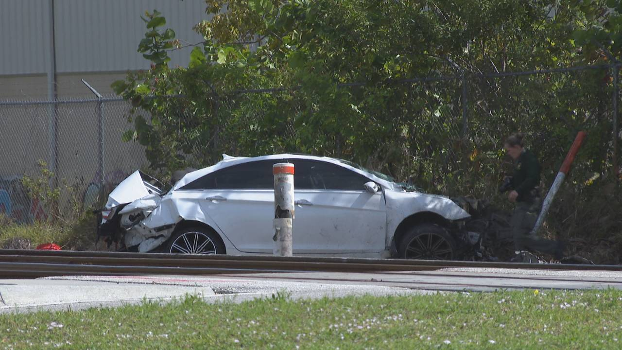 Driver hurt after car slams into side of Tri-Rail train