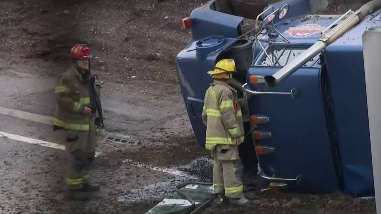 Pickup truck falls on top of SUV 2