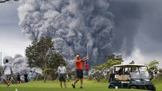 A little volcanic eruption can't ruin a day on the golf course in Hawaii