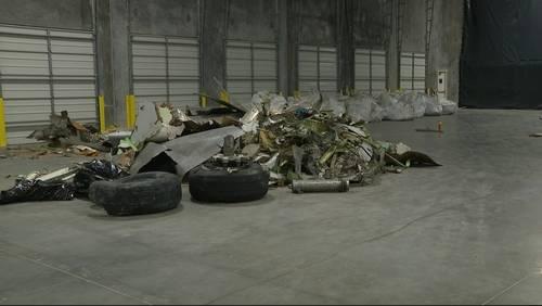INSIDE LOOK: Debris from deadly cargo plane crash held in warehouse
