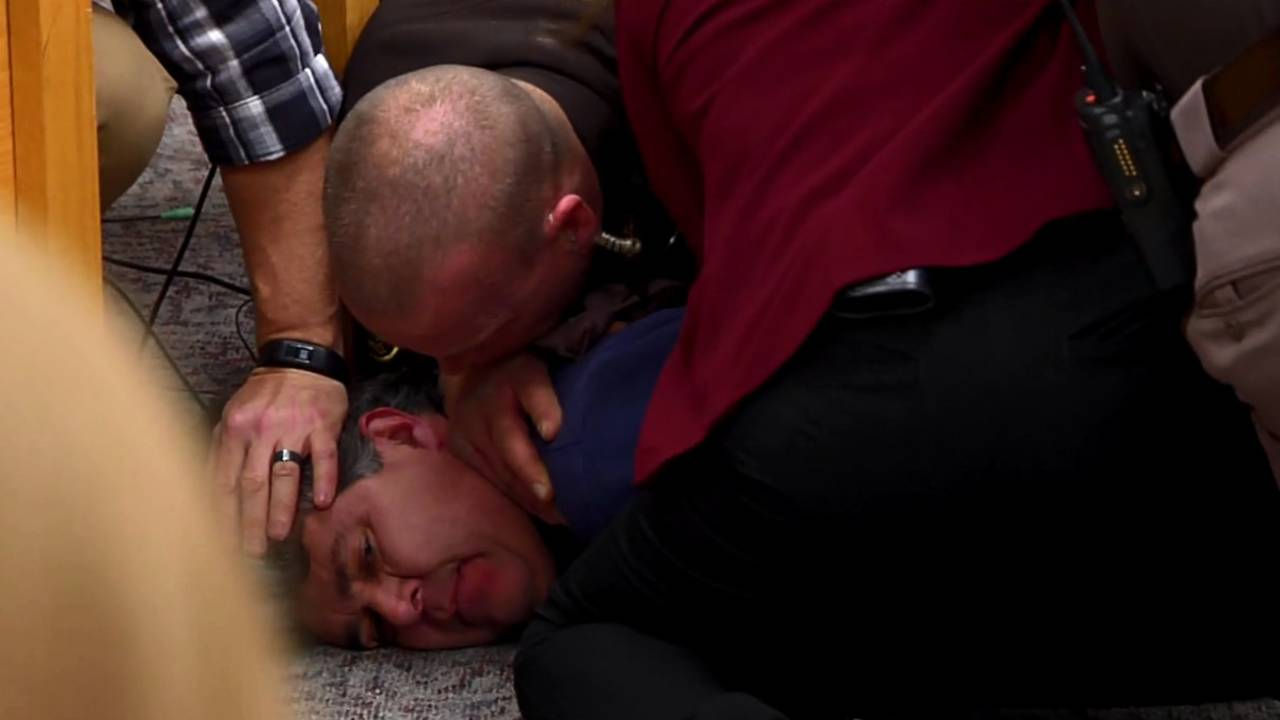 Father held down after charging at Nassar