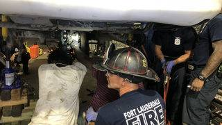 Firefighters free man whose hand got stuck while repairing taxi