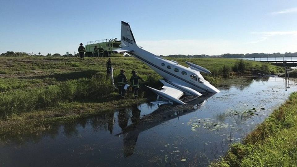 Plane in water at Orlando Executive