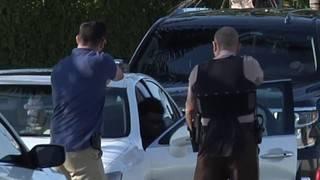 Police take down suspect found sitting in Lexus stolen during carjacking