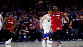 Wade leads Heat to 113-103 road win, ties series with 76ers