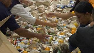 Bahamians get much-needed food among death, destruction