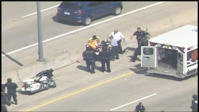 DPD motorcycle officer crash loaded onto ambulance