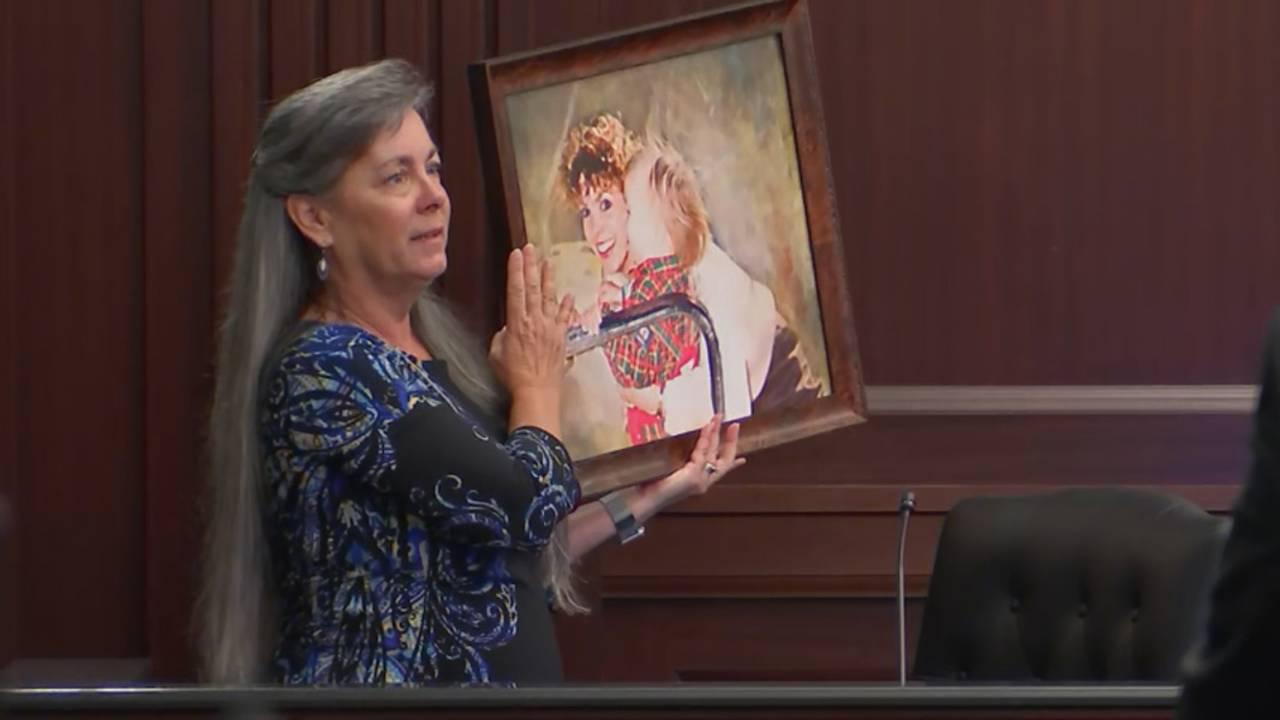 Bonnie Haim's sister holds portrait