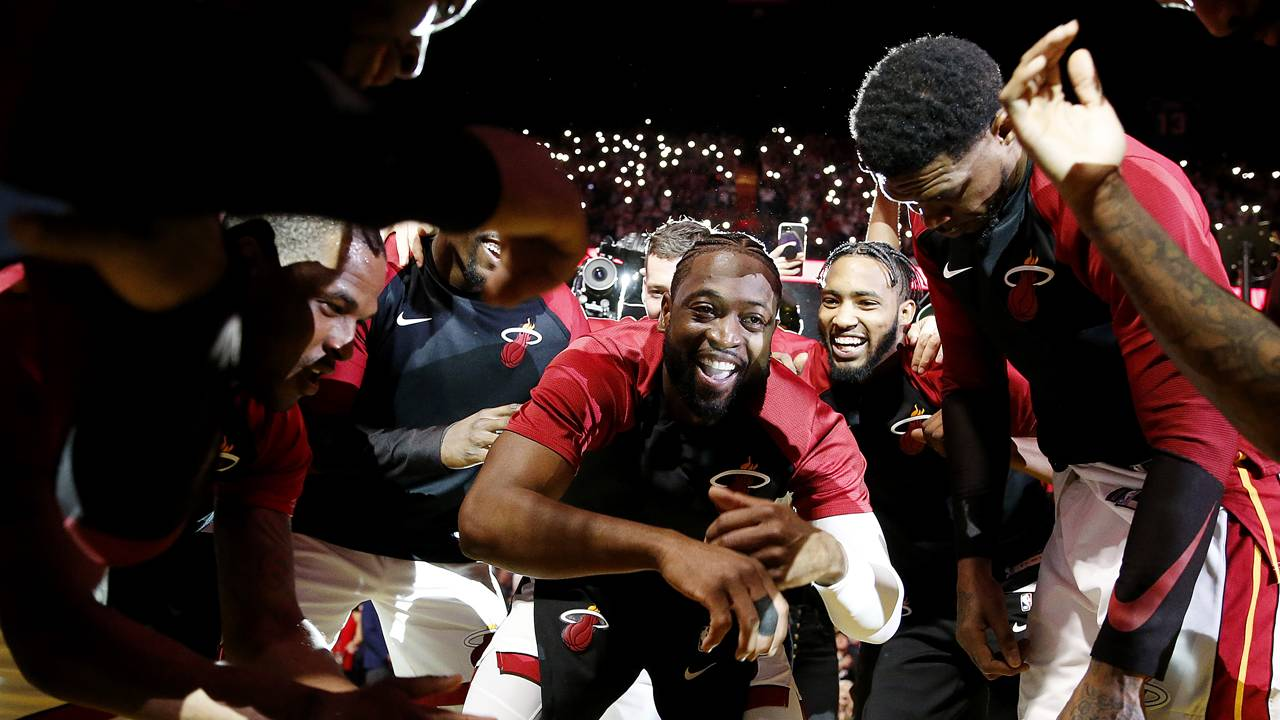 Dwyane Wade celebrates with Miami Heat teammates before final home game, April 9, 2019