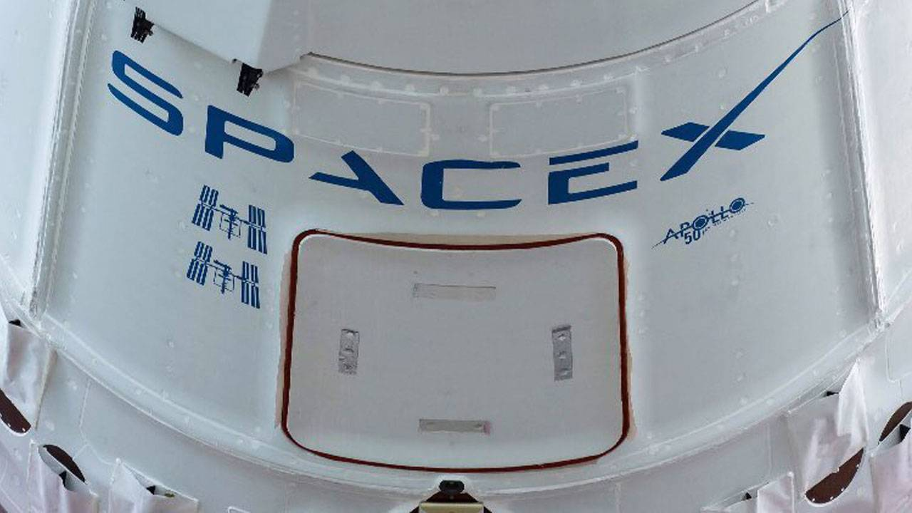 SpaceX rocket launches between clouds sending supplies to