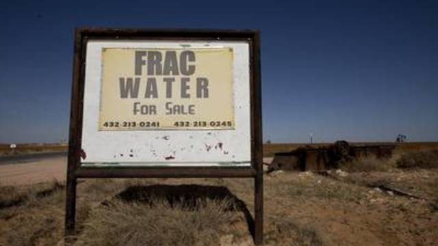 A homemade sign on Moore School Road in Big Spring advertises oilfield water for sale.