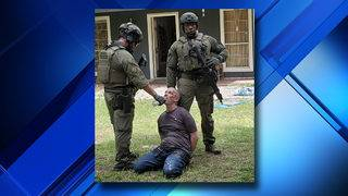 Standoff ends with arrest of man accused of assaulting elderly woman