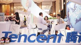 China's Facebook rival, Tencent, nearly doubles its profit