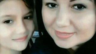 Vigil held for mother, daughter who vanished a year ago