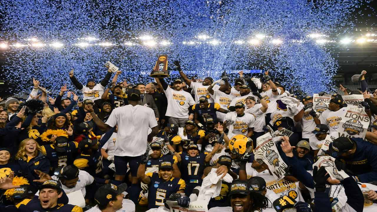 Texas A&M-Commerce Lions and coach Colby Carthel celebrate 2017 Division II national championship