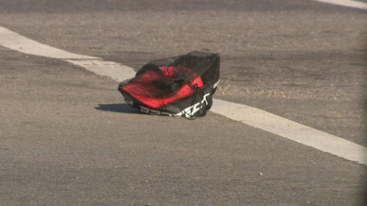 9-year-old boy and mother hit by truck Detroit backpack