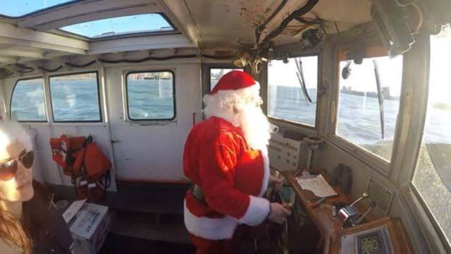 video santa uses jw westcott boat to deliver lobsters - Does Mail Get Delivered On Christmas Eve