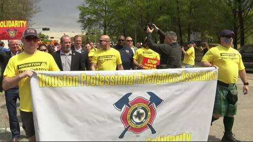 Firefighters march to City Hall, protest after mayor announces potential layoffs