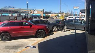 Car hits 4 parked vehicles in front of Woodland Theater