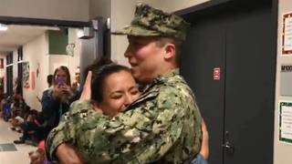 SWEET REUNION: Naval officer surprises wife, Fort Bend ISD